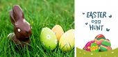 pic of easter eggs bunny  - easter egg hunt graphic against chocolate bunny in the grass with easter eggs - JPG