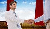 foto of curtains stage  - Two businessmen shaking hands in office against stage with red curtains - JPG