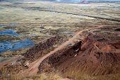 foto of dump  - red dump waste rock from coal mine Komsomolskaya city Kopeysk - JPG
