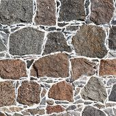 foto of cobblestone  - Cobblestone wall fragment texture as abstract background composition - JPG