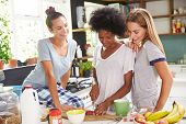 picture of three life  - Three Female Friends Enjoying Breakfast At Home Together - JPG
