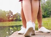 pic of pier a lake  - couple kissing on the pier near lake in hot summer day summer concept  - JPG