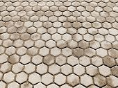 stock photo of cobblestone  - Urban road is paved with blocks of stone cobblestone walkway sepia - JPG