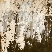 stock photo of nail paint  - Abstract background gloomy concrete wall casually painted dark green paint weathered with cracks and scratches in the wall hammered a rusty nail - JPG