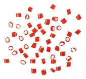 stock photo of foreshortening  - Multiple red and white candy sweets spilled over the white surface - JPG