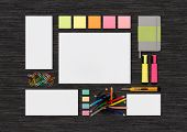 image of letterhead  - Top view of blank colorful template on black desk for corporate branding identity presentation or portfolio - JPG