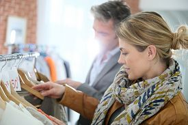 picture of maturity  - Mature couple shopping in clothing store - JPG