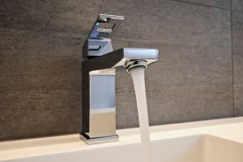 stock photo of split ends  - Very high end faucet sink and counter in a luxury bathroom  - JPG
