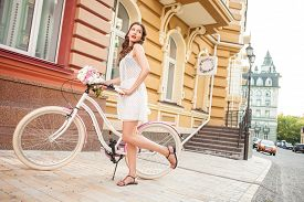 stock photo of women rights  - Beautiful woman is riding the bicycle and posing - JPG