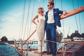 picture of yacht  - Stylish wealthy couple on a luxury yacht  - JPG