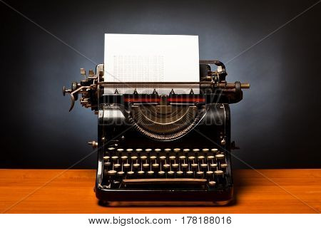 typewriter with sheet of paper saying 'all work and no play makes jack a dull boy'