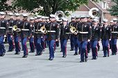 The Usmc Marine Forces Reserve Band Marching In A Parade