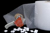 Packaging supplies with bubble wrap on a black background