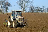 Ploughing an empty field in late winter - UK