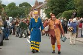 ABBOTS BROMLEY, STAFFORDSHIRE, UK - SEPTEMBER 8: The Fool and Maid Marian lead the parade of the annual ceremonial Horn Dance through Abbots Bromley, September 8 2008, Abbots Bromley, Staffordshire