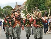 ABBOTS BROMLEY, STAFFORDSHIRE, UK - SEPTEMBER 8: The Abbots Bromley Horn Dancers Parade Down the Main Street in Abbots Bromley, September 8 2008, Abbots Bromley, Staffordshire, UK