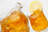 stock photo of iced-tea  - Jug and glass of iced tea for the summer  - JPG