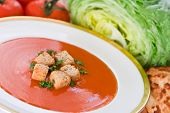 Tomato flavoured soup with croutons