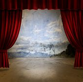 Small stage with red velvet theater curtains