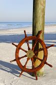 Ship's Wheel At The Ocean