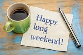 Happy long weekend  - handwriting on a napkin with a cup of espresso coffee poster