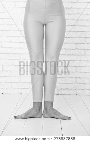 901848f53 Poster of First Ballet Position Of Female Feet In Orange Tights. Leg Of  Dancer In First Position. Dance Class