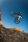 Mtb Bike Jump Over A Dirt Trail poster