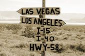 Directional sign in the Mojave Desert directing travelers to Los Angeles or Las Vegas