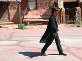 A Calico Gunfighter strolls through the streets of the 1889 Silver boom town of Calico. Located in t