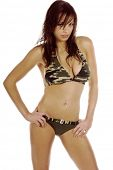 Sexy redheaded model in a camoflage bikini  isolated over white