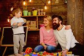 Play Concept. Little Child With Mother And Father Play With Toy Bricks. Creative Family Play. The Be poster