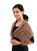 Beautiful young Mexican woman in a black shirt and a couture tan  multi-hued feather wool shawl acce