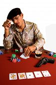 Mexican man playing Texas Hold um Poker with a pistol on the table