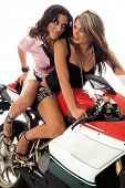 image of crotch-rocket  - Two super beautiful woman on a red and white street bike - JPG