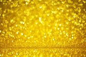 Golden Shiny Glitter Holiday Beautiful Background With Bokeh Shape Hearts. Studio Shot. Valentine Or poster