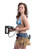 Cute young woman in Daisy Duke denim shorts, bikini top and a framers tool belt as if she were a construction worker