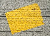 Yellow Sticker On Concrete Background