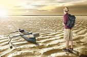 Rear View Of Asian Traveler Looking At Drying Water On The Lake. Climate Change Concept poster