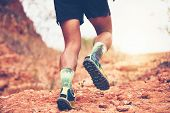 A Man Runner Of Trail . And Close Up Of An Athletes Feet Wearing Sports Shoes For Trail Running In  poster