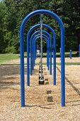 stock photo of swingset  - A blue swingset in a neighborhood park - JPG