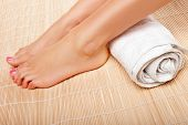 Womans Feet With A Rolled Towel