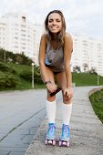 pic of roller-derby  - woman in roller skates during the sunset - JPG
