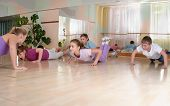 Group of children engaged in physical trainingindoors.