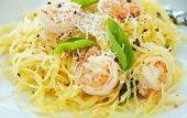stock photo of substitutes  - Fresh spaghetti squash with basil and sauteed shrimp in wine sauce - JPG