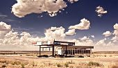 foto of gasoline station  - Old gas station in ghost town along the route 66 at border of the desert - JPG