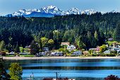 stock photo of olympic mountains  - Poulsbo Bainbridge Island Puget Sound Snow Mountains Olympic National Park Washington State Pacific Northwest - JPG