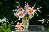 stock photo of pompous  - still life bouquet with hemerocallis in a dark background - JPG