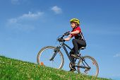 Child Kid Or Boy Cycling On Bicycle With Helmet