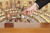 Gavel in hand against the background of the courtroom