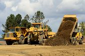 picture of big-rig  - A large track bulldozer and a large articulating dump truck at a new road project in Oregon - JPG